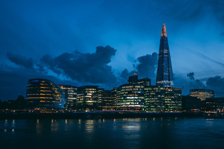 Modern London skyline on River Thames at night