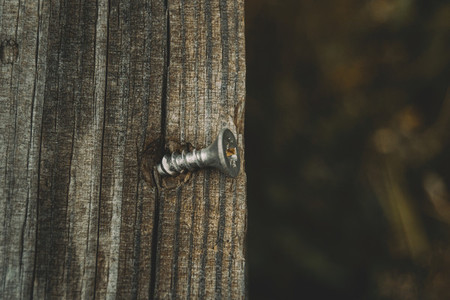 close up rough wooden and rusty nail background