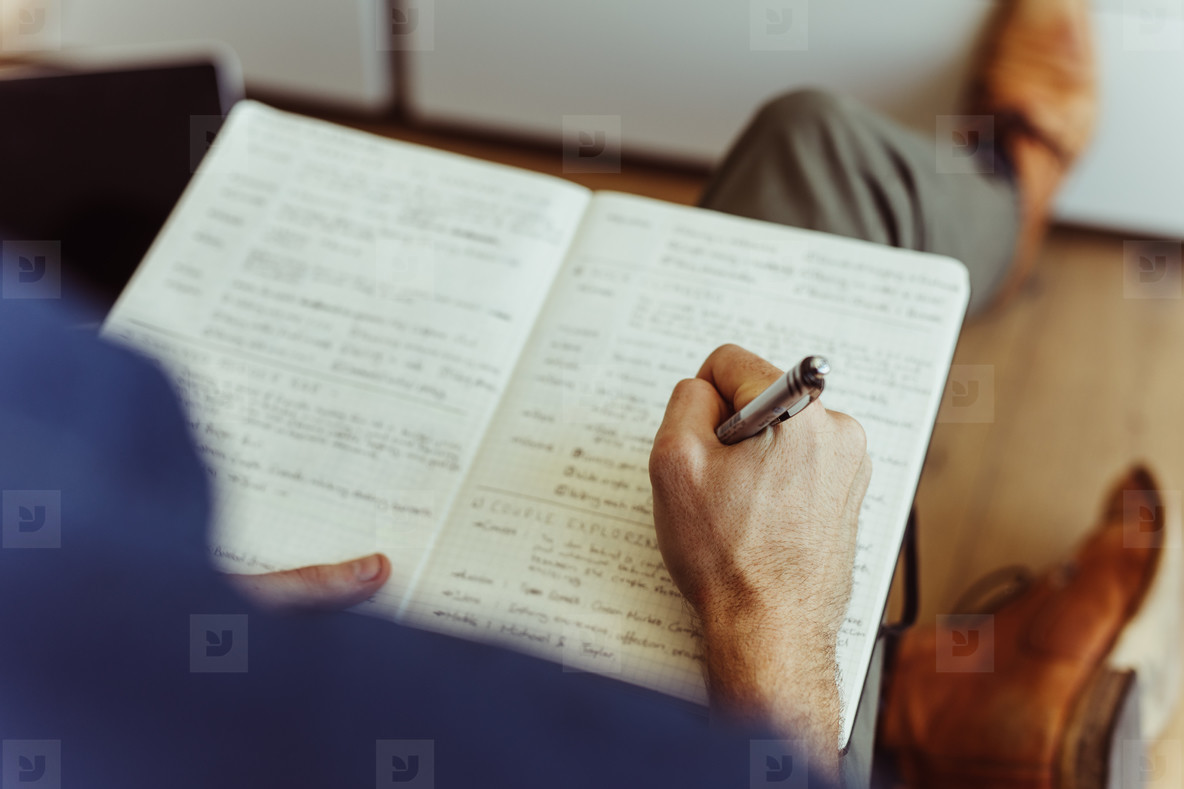 Man making notes in his diary