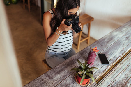 Woman taking photo for her blog