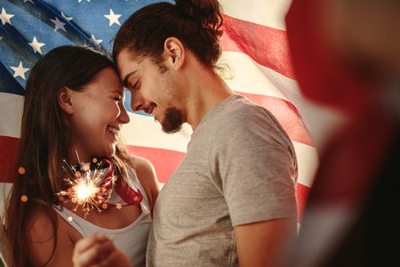 American couple celebrating independence day