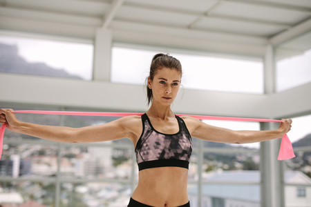 Female training with resistance band at gym