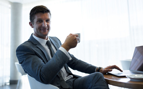 Businessman having a coffee break at office