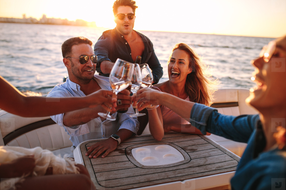 Friends on yacht drinking together