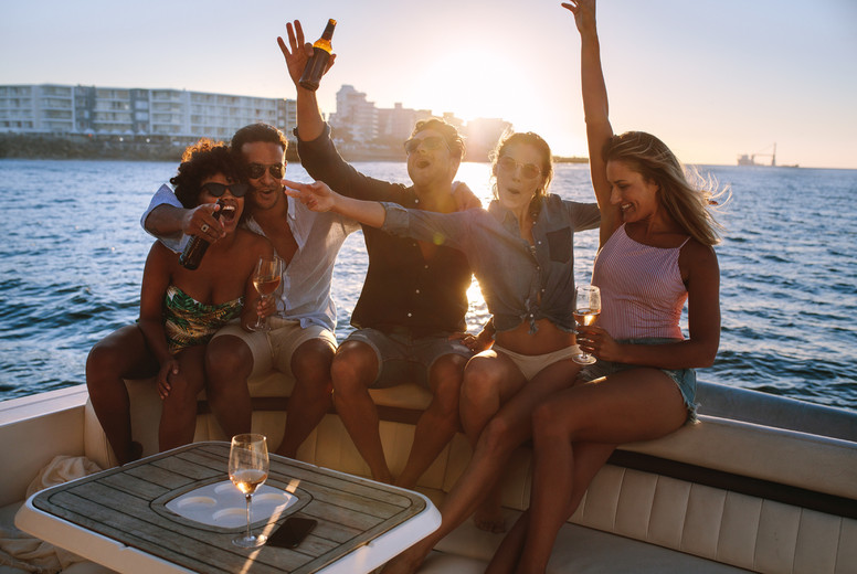 Cheerful friends partying on boat
