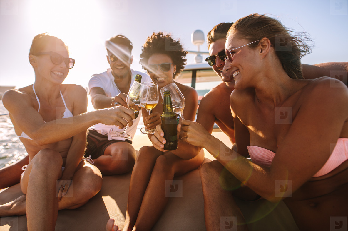 Multi ethnic friends partying on a boat