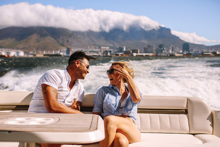 Couple traveling by a boat and laughing