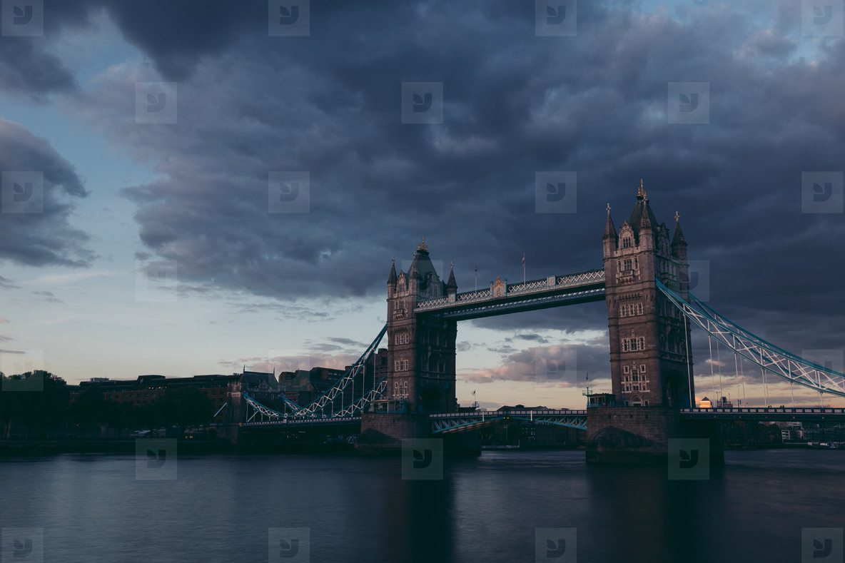 Moody dark shot of Tower Bridge on London skyline at sunset