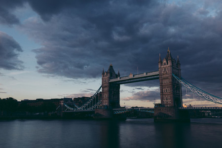 Moody dark shot of Tower Bridge on London skyline at sunset
