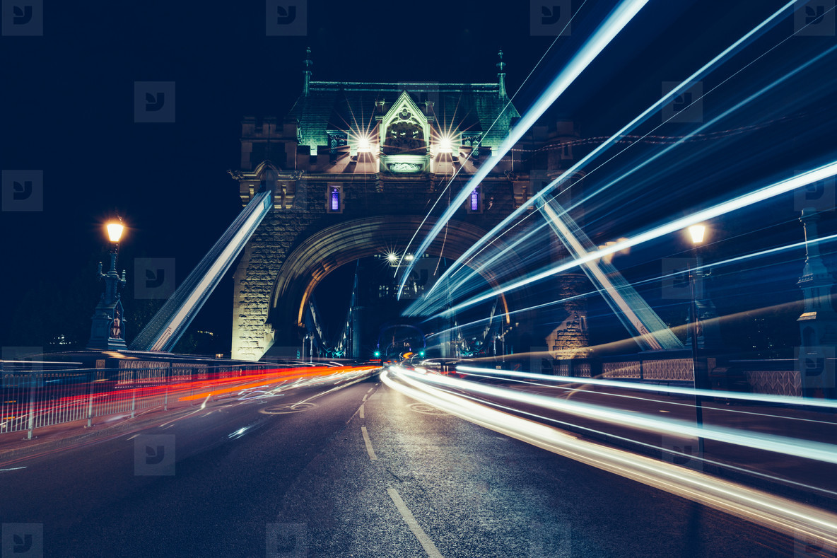 City light trails of traffic on Tower Bridge London at night