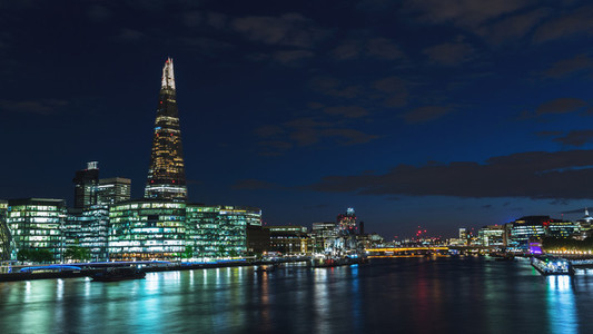 Panoramic view of London skyline at night on River Thames