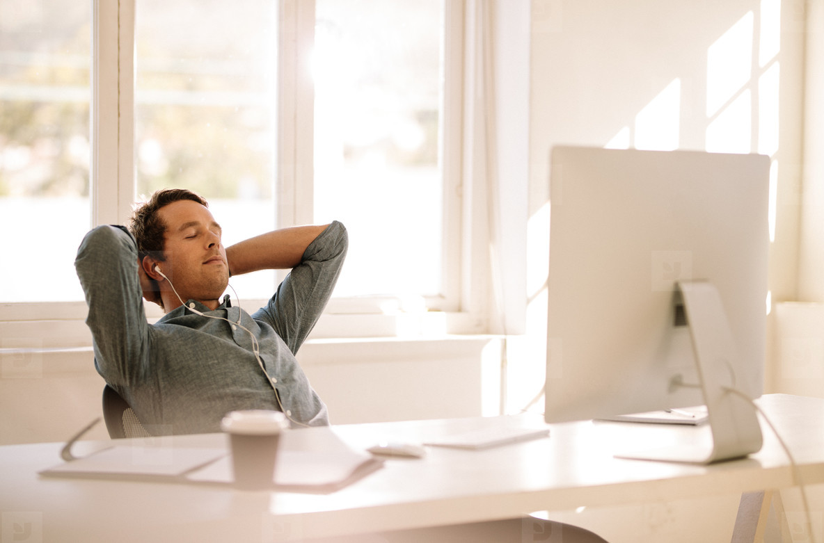 Freelance entrepreneur relaxing sitting in front of computer