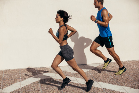 Two runners running outdoors in morning