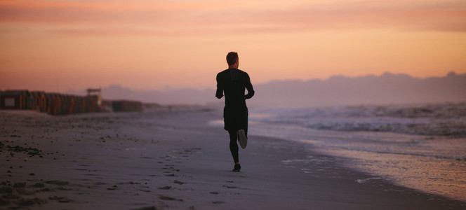 Man running by the sea in morning
