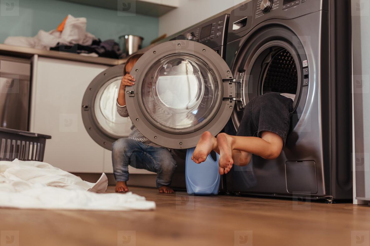 Kids having fun with washing machines