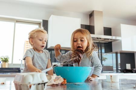 Small kids preparing cake batter