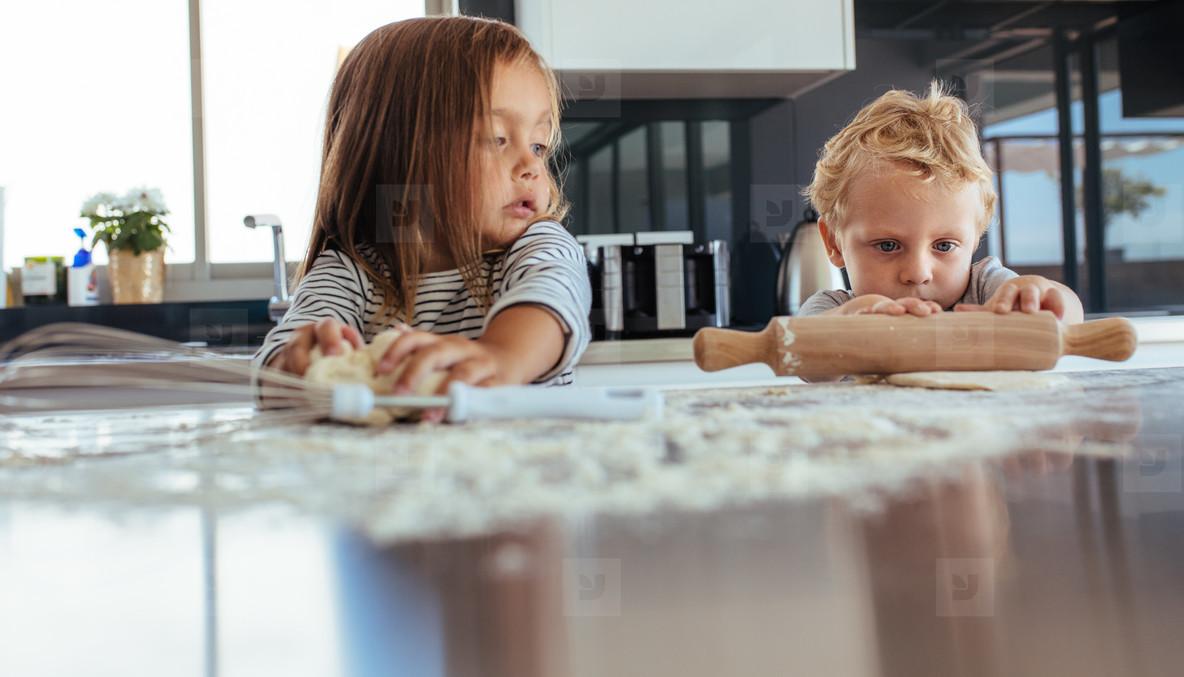 Kids preparing cookies in kitchen