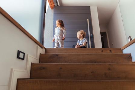 Kids on stairway looking outside