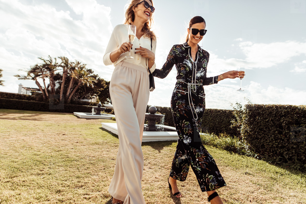 Stylish women walking together and smiling