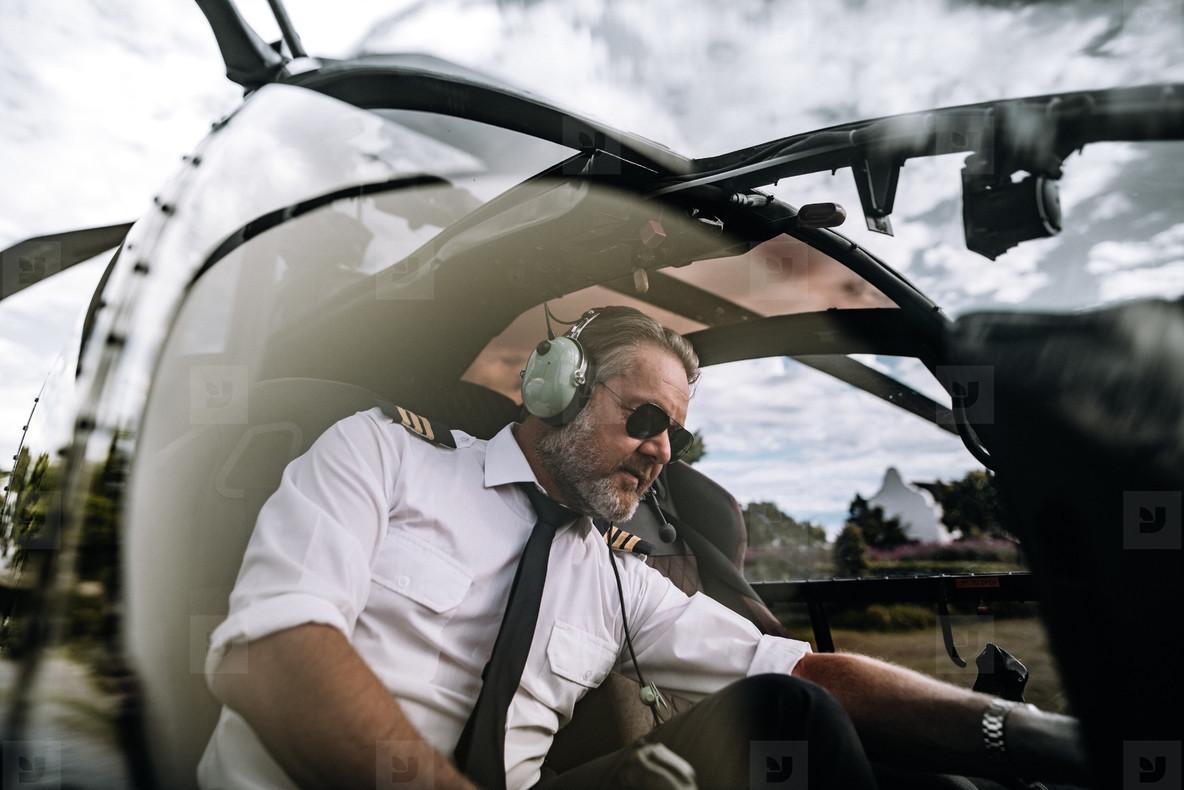 Pilot inside helicopter cockpit