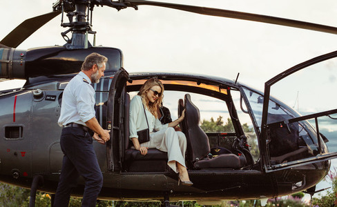Beautiful woman travelling by her helicopter