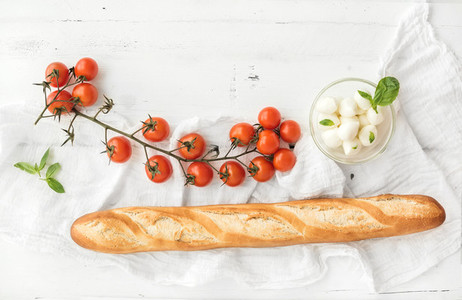 Baguette with banch of cherry tomatoes  basil and mozzarella cheese