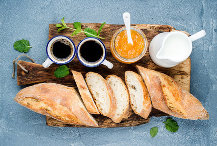Breakfast set  Baguette  orange jam and coffee in cups