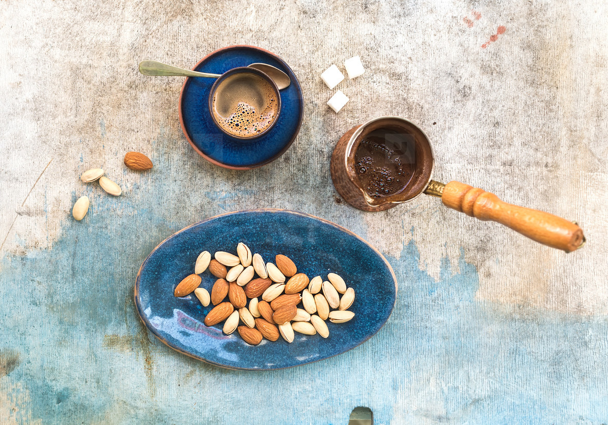 Black coffeee with almonds and pistachios