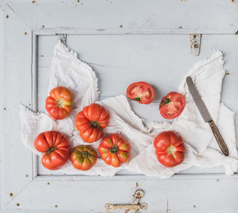 Fresh ripe hairloom tomatoes in rustic blue wooden tray