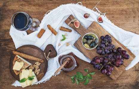 Glass of red wine cheese board grapes