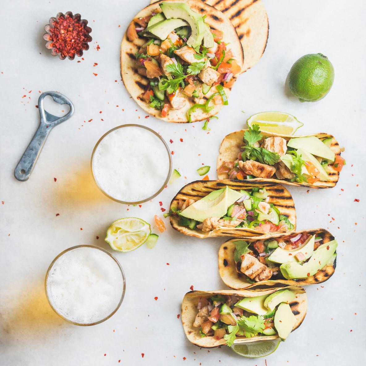 Healthy corn tortillas with chicken  avocado  salsa  limes and beer
