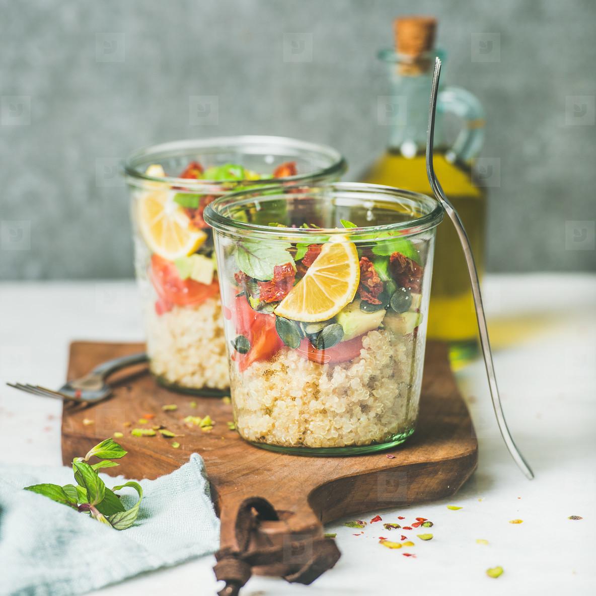 Healthy vegan salad with quionoa  avocado  dried tomatoes  square crop