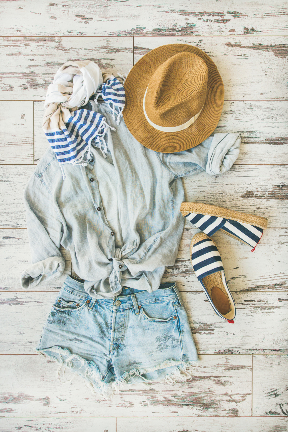 Summer outfit flatlay  parquet background  top view