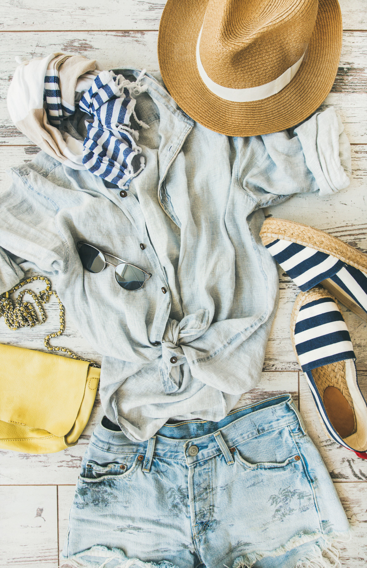 Summer womans outfit flatlay  top view  vertical composition