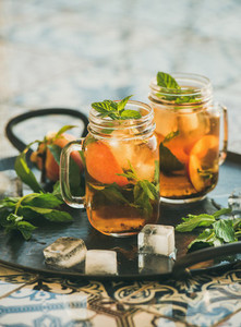 Summer refreshing cold peach ice tea with mint  copy space