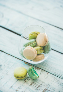 Colorful pastel French macaron biscuits in glass  copy space
