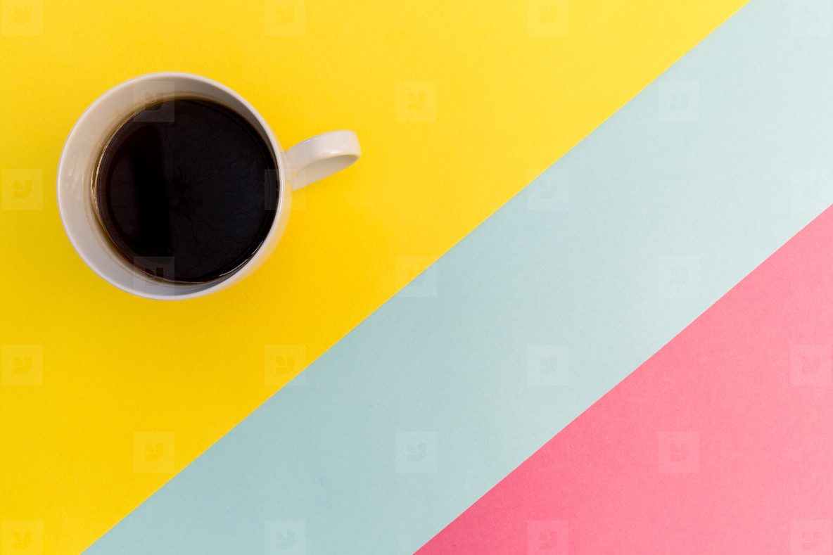 Coffee cup on minimal yellow background