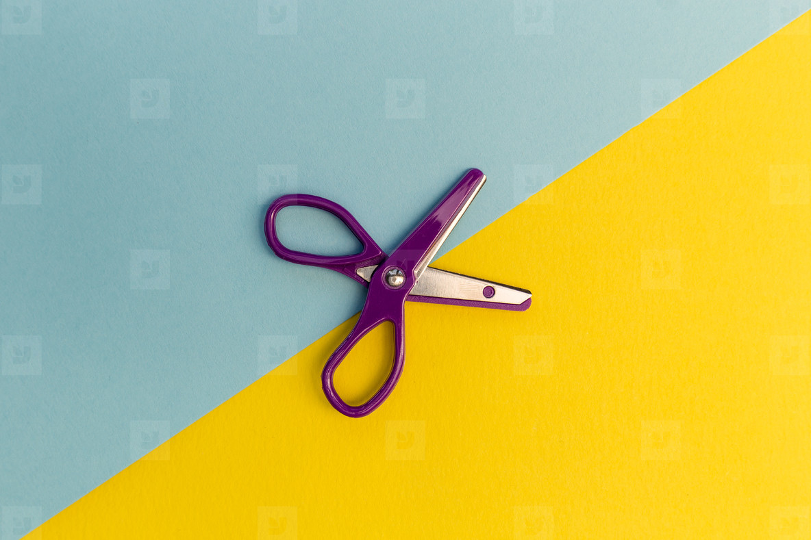 Scissors cutting line stationery concept