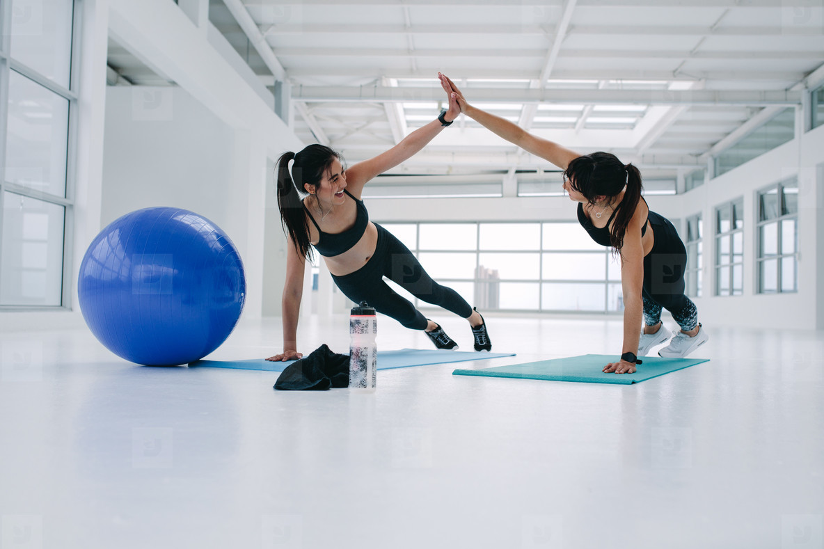 Women working out together at fitness studio