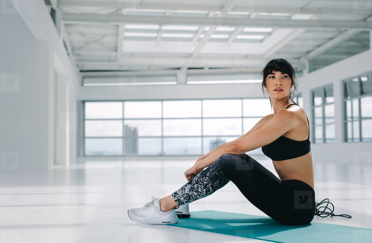Woman resting after workout at fitness studio