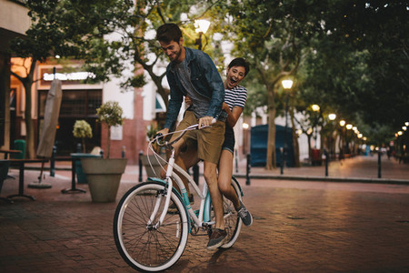Young couple on bike ride in the city