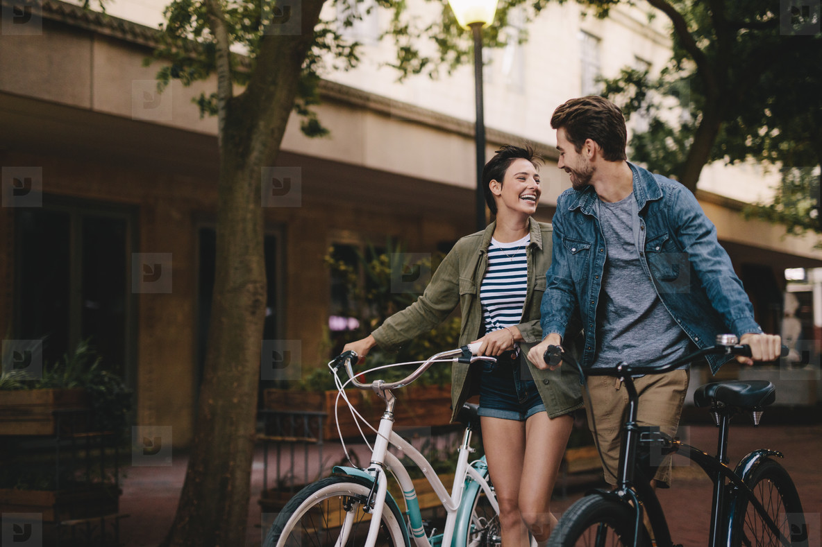 Couple with bicycles on the street