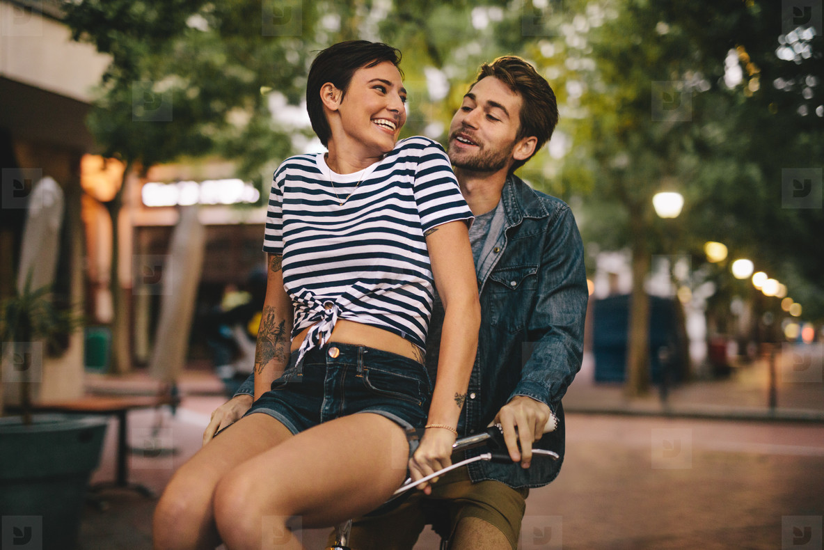 Couple enjoying on bicycle in the city