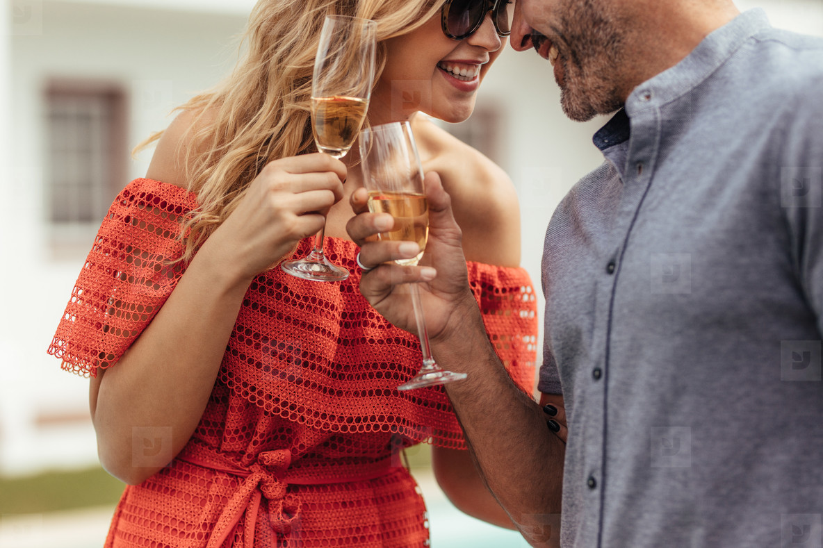 Romantic couple toasting glasses