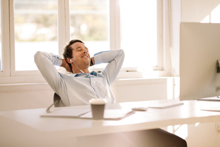 Entrepreneur relaxing sitting in front of computer