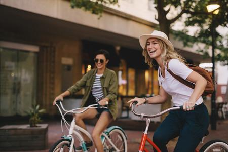 Female friends enjoying bicycle ride