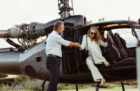 Wealthy woman traveling by her helicopter
