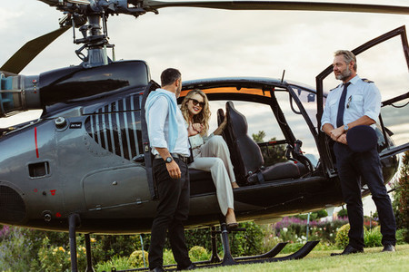 Couple traveling by a private helicopter