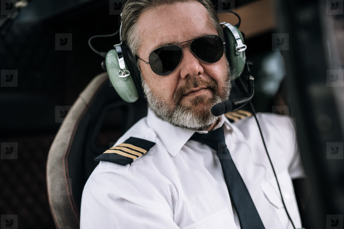 Confident male helicopter pilot