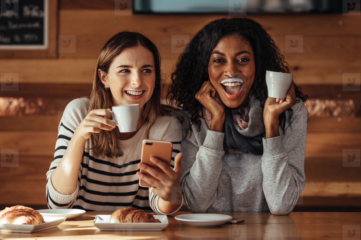 Friends sitting in a cafe drinking coffee